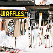 Skis line the walls and snow banks of Corbet's Cabin on the top of Rendezvous Bowl off of the aerial tramway for Jackson Hole Mountain Resort, Teton Village, Wyoming.