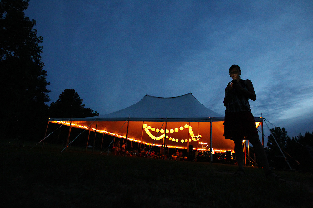 Activity continues into the night under tents at the Wild Goose Festival at Shakori Hills in North Carolina June 23, 2011.  (Photo by Courtney Perry)