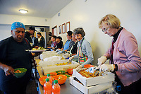 Volunteer June Anderson, right, serves lunch at the First Methodist Church  in Salinas. The program provides meals, counseling resources and occasional shelter to many who need assistance.