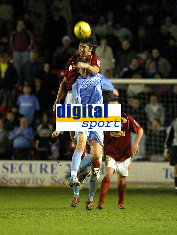 Photo: Dave Linney.<br />Walsall v Tranmere Rovers. Coca Cola League 1.<br />26/12/2005.Ian Roper (Walsall) beats  Steve Davies(Tranmere) to the ball.