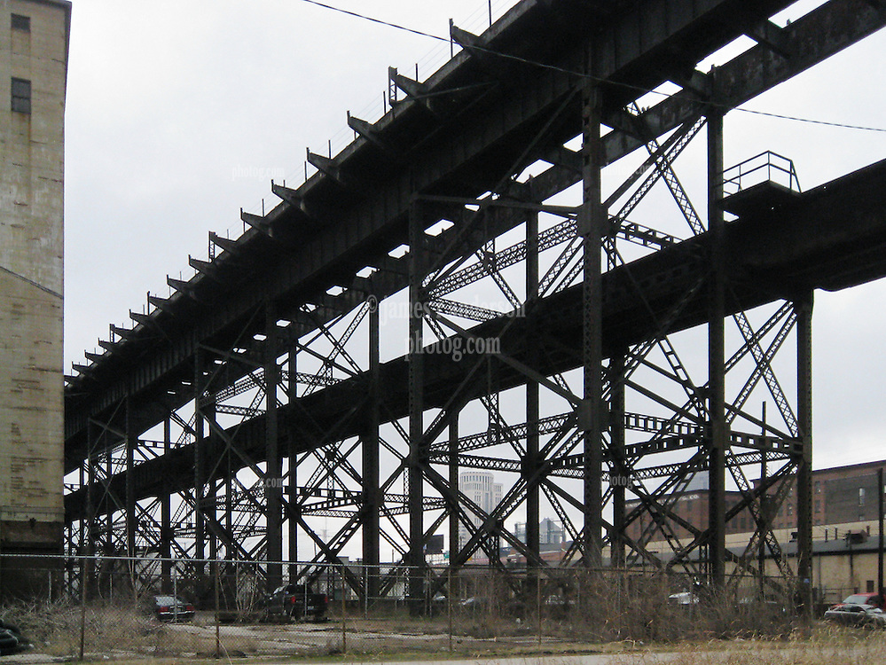 Railroad Overpass in an Aging Industrial Area, nearby the Gateway Arch and Jefferson National Expansion Park, Saint Louis MO. View West along South 1st Street.