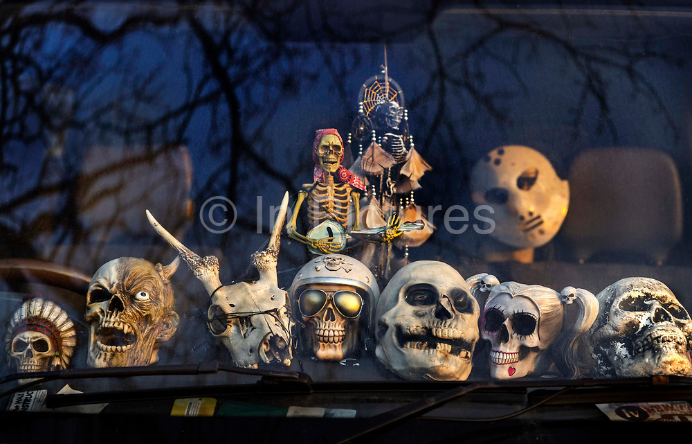 A macabre display of skulls in the windscreen of a van on 27th March 2021 in London, United Kingdom.