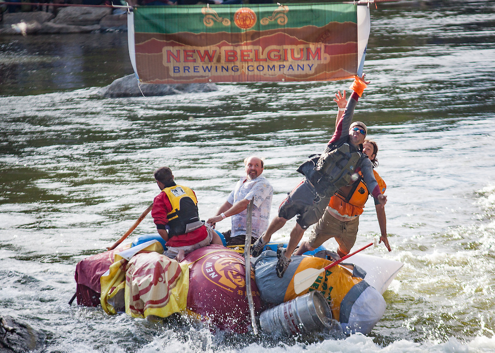 Crowds and participants enjoy the Hooligan Race at the Whitewater Park during the FibArk river festival.