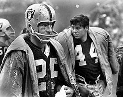 Oakland Raiders Fred Biletnikoff and Marv Hubbard standing in the rain..(1972 photo/Ron Riesterer)