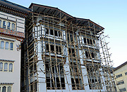 A new concrete building built in a superficially traditional style. Bamboo scaffolding  is being used. Thimpu, Druk Yul, Bhutan. 13 November 2007.