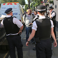 White City Tower Block Wednesday 14th June 2017  Man arrestted for opening body bag outside the tower block after a man jumped from the Eight floor at 1.30 on the morning More than 30 people are feared dead .Exculsive ©UKNIP