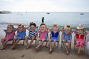 A giant message in a bottle has washed up on the beach from countries ravaged by climate change, but the G7 leaders are too busy relaxing in their swimming costumes in deckchairs to notice, Oxfam campaigners pose as G7 leaders on a beach on the 12th of June 2021 near Falmouth, Cornwall, United Kingdom. Oxfam is calling on the G7 countries to commit to cutting emissions further and faster and provide more finance to help the most vulnerable countries respond to the impacts of climate change.
