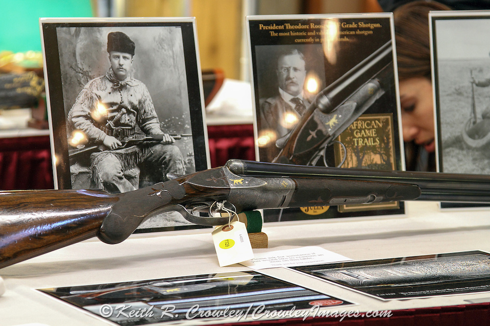 Display of Teddy Roosevelt's Fox shotgun, along with various photos and TR memorabilia in the preview area at the James D. Julia auction house in Fairfield, Maine.