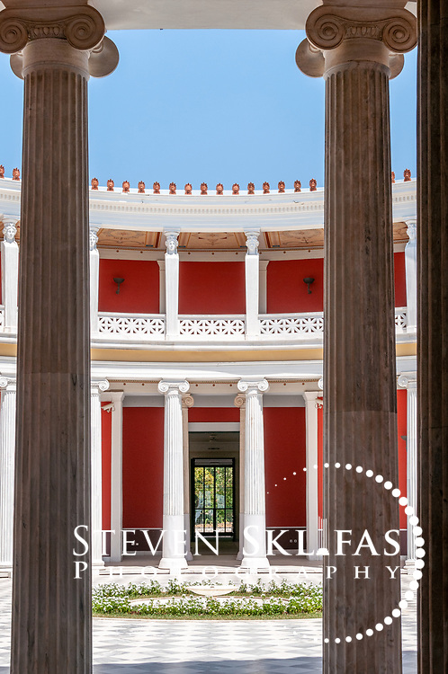 Athens. Greece. Part view of the monumental circular interior two story peristyle of the neoclassical Zappeion located at the southern end of the National Gardens in Athens. Designed by Th. Hansen and constructed from 1874-1888, the building was the first building specially built for the 1896 Olympic Games, in which it was used for the fencing competition. It was also used during the 2004 Olympics as a press and events centre.
