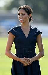 Meghan, Duchess of Sussex, wearing a navy blue dress by Carolina Herrera,  attends the Sentebale ISPS Handa Polo Cup at the Royal County of Berkshire Polo Club on July 26, 2018.