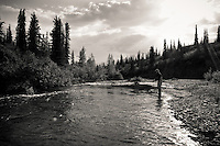 Angler George Rogers fly casting for king salmon on the Middle Fork of the Chulitna River, Alaska