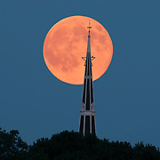 """Full """"Super"""" moon over the Baptist Church of Wakefield, MA. In November 2018 a lightning bolt struck the 180 foot church spire, and the 150 church burned to the ground.<br /> <br /> A portion of the proceeds from the sale of prints will go to a rebuilding fund."""