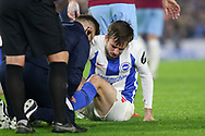Brighton and Hove Albion midfielder Davy Propper (24) receives attention after injury during the Premier League match between Brighton and Hove Albion and West Ham United at the American Express Community Stadium, Brighton and Hove, England on 5 October 2018.