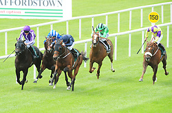 Merchant Navy (centre left) ridden by jockey Ryan Moore wins the Weatherbys Ireland Greenlands Stakes during day one of the 2018 Tattersalls Irish Guineas Festival at Curragh Racecourse, County Kildare.