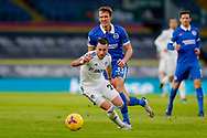 Leeds United midfielder Jack Harrison (22), on loan from Manchester City, and Brighton and Hove Albion defender Dan Burn (33) in action during the Premier League match between Leeds United and Brighton and Hove Albion at Elland Road, Leeds, England on 16 January 2021.