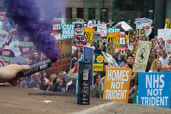London, June 20th 2015. Tens of thousands of people converge on the streets of London to join the People's Assembly Against Austerity's march from the Bank of England to Parliament Square.