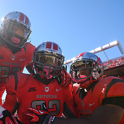 Oct 13, 2012: Rutgers Scarlet Knights defensive back Duron Harmon (32) celebrates his touchdown on a blocked field goal return with teammates linebacker Khaseem Greene (20) and defensive back Logan Ryan (11) during NCAA Big East college football action between the Rutgers Scarlet Knights and Syracuse Orange at High Point Solutions Stadium in Piscataway, N.J.