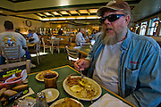 Truck driver and former biker Conrad Tolby having breakfast in a restaurant at a truck stop at the intersection of I-70 and I-57 in Effingham, Illinois. (Conrad Tolby is featured in the book What I Eat: Around the World in 80 Diets.) MODEL RELEASED.