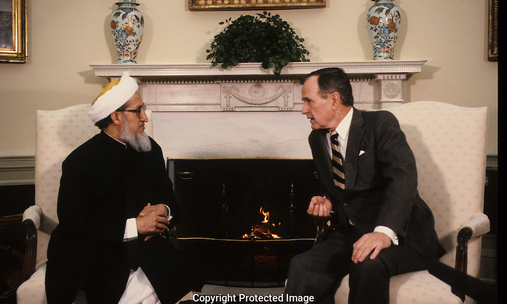 President H W Bush  (Bush 41) meets with Sibhatulla head of the Afghan National Government during the administration of H.W. Bush (Bush 41)..Photograph by Dennis Brack, BB 29