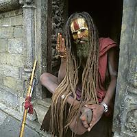 KATHMANDU, NEPAL. Hindu ascetic in pilgrim's shelter at Pashupatinath Temple, one of holiest shrines for Shiva.