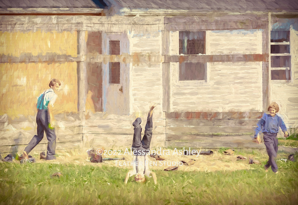 Three Amish boys outside an Amish schoolhouse at recess, one boy in a headstand while the others look on in amusement.