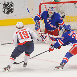 May 12, 2012: New York Rangers goalie Henrik Lundqvist (30) makes a save on Washington Capitals center Nicklas Backstrom (19) during first period action in game 7 of the NHL Eastern Conference Semi-finals between the Washington Capitals and New York Rangers at Madison Square Garden in New York, N.Y.