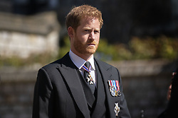 Prince Harry walks in the procession at Windsor Castle, Berkshire, during the funeral of the Duke of Edinburgh. Picture date: Saturday April 17, 2021.