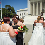 Shannon Glatz, left, and Liberty Manos, of Akron, Ohio, recite their vows in front of the Supreme Court of the United States, on Friday, June 21, 2013.  Twenty-five gay couples traveled to Washington to get married en masse the week before decisions are expected to be made on the Defense of Marriage Act (DOMA) and Proposition 8.  John Boal photography