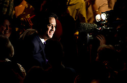 © London News Pictures. 24/09/2013 . Brighton, UK.  ED Labour party leader ED MILIBAND lit by a television camera as he leaves the stage after delivering his Key-note speech on the third day of the Labour Party Conference in Brighton. Photo credit : Ben Cawthra/LNP