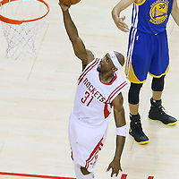 25 May 2015: Houston Rockets guard Jason Terry (31) goes for the layup past Golden State Warriors guard Stephen Curry (30) during the Houston Rockets 128-115 victory over the Golden State Warriors, in game 4 of the Western Conference finals, at the Toyota Center, Houston, Texas, USA.