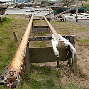 Harold Burnham is the 28th member of his family to design and build boats on the Essex River in Essex, Massachusetts. These spars are being restored for use on a wooden sailing vessel