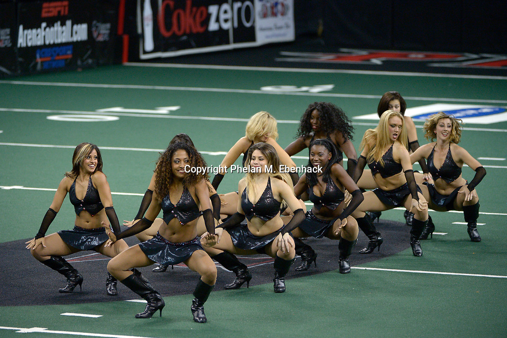 Orlando Predators cheerleaders perform during the first half of an AFL playoffs football game against the Pittsburgh Power in Orlando, Fla., Sunday, Aug. 3, 2014. (Photo by Phelan M. Ebenhack)