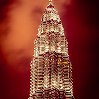 Pinnacle of one of the Petronas Twin Towers  at dusk surrounded by a burning sky, Kuala Lumpur, Malaysia