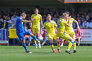 AFC Wimbledon striker James Hanson (18) shoots at goal during the EFL Sky Bet League 1 match between AFC Wimbledon and Bristol Rovers at the Cherry Red Records Stadium, Kingston, England on 19 April 2019.