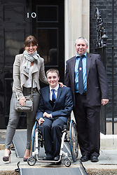 © Licensed to London News Pictures. 17/03/2014. London, UK. Davina McCall poses outside Downing Street with guests at a Sport Relief reception hosted by the Prime Minister, David Cameron on 17th March 2014. Photo credit : Vickie Flores/LNP