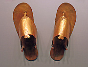 Gold sandals, toe and finger stalls. Dynasty 18, reign of Thutmose 111 (ca.1479-1425 B.C.) Gold.  From the tomb of the three minor wives of Thutmose 111, in the Wady Gabbanat el-Qurud, Thebes.