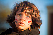 31 JANUARY 2011 - TEMPE, AZ: An Egyptian flag painted on the cheeks of ADAM ABDALLAH, 5, during a demonstration in Tempe, AZ, Monday in support of democracy in Egypt. About 200 people marched through central Tempe, AZ, near the Arizona State University campus Monday afternoon. The rally was organized by the Arab American Association of Arizona in solidarity with the ongoing pro-democracy rallies and demonstrations in Egypt and other Arab countries.    Photo by Jack Kurtz