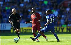 Georginio Wijnaldum of Liverpool is challenged by Junior Hoilett of Cardiff City - Mandatory by-line: Nizaam Jones/JMP - 21/04/2019 -  FOOTBALL - Cardiff City Stadium - Cardiff, Wales -  Cardiff City v Liverpool - Premier League