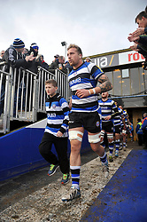 Bath captain Dominic Day, mascot in hand, leads his team out onto the field - Photo mandatory by-line: Patrick Khachfe/JMP - Tel: Mobile: 07966 386802 25/01/2014 - SPORT - RUGBY UNION - The Recreation Ground, Bath - Bath Rugby v Cardiff Blues - LV= Cup.