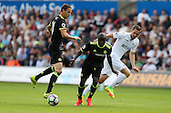 N'Golo Kante © and Nemanja Matic of Chelsea (l) stop Gylfi Sigurdsson of Swansea city. Premier league match, Swansea city v Chelsea at the Liberty Stadium in Swansea, South Wales on Sunday 11th Sept 2016.<br /> pic by  Andrew Orchard, Andrew Orchard sports photography.