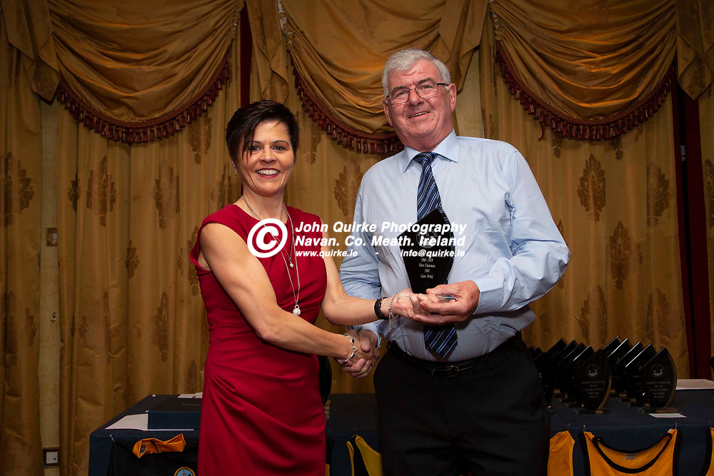 27/10/2019, Bohermeen Athletic Club 50th Anniversary celebration at the Ardboyne Hotel, Navan.<br /> Olivia Martin makes a presentation to founding officer of the Bohermeen AC club - Liam Brady<br /> Photo: David Mullen / www.quirke.ie ©John Quirke Photography, Unit 17, Blackcastle Shopping Cte. Navan. Co. Meath. 046-9079044 / 087-2579454.<br /> ISO: 400; Shutter: 1/200; Aperture: 6.3; <br /> File Size: 2.4MB