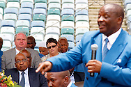 DURBAN - 4 December 2016 - South Africa's President Jacob Zuma (bottom left) looks on as Professor Caesar Nongqunga, the leader of the 4.5 million strong Twelve Apostles Church in Christ speaks at a thanksgiving service in Durban's Moses Mabhida Stadium. Nongqunga later urged church members to deposit their savings intoo the same bank that had earlier in the year given Zuma a loan to pay for the controversial non-security upgrades to his personal residence in Nkandla. Picture: Allied Picture Press/APP
