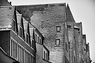 snow-covered roofs of the building Rheinkontor and the old storehouse at the Rheinau harbor, Cologne, Germany. <br /> <br /> schneebedeckte Daecher des Rheinkontors und der alten Speichergebaeude im Rheinauhafen, Koeln, Deutschland.