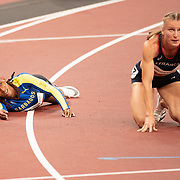 TOKYO, JAPAN August 4:  Sada Williams of Barbados who finished in third place and Amandine Brossier of France who finished in sixth place react at the finish of the 400m semi-final 3 for women during the Track and Field competition at the Olympic Stadium at the Tokyo 2020 Summer Olympic Games on August 4th, 2021 in Tokyo, Japan. (Photo by Tim Clayton/Corbis via Getty Images)