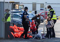 © Licensed to London News Pictures. 07/10/2021. DOVER, UK. Migrants arriving in border force boat at Dover docks. Photo credit: Stuart Brock/LNP