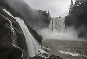 Snoqualmie Falls was in full swing with snow in the mountains melting causing and the rivers in the region swelling.  The little mini falls at left adds to the flow of the Snoqualmie River. (Steve Ringman / The Seattle Times)