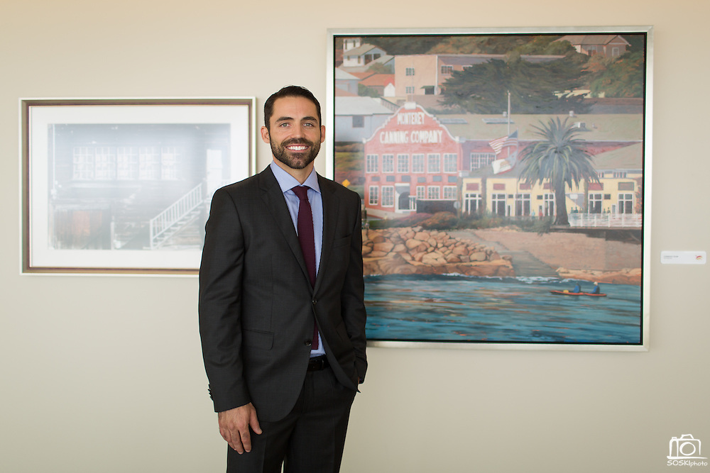 Nick Brown poses for a portrait with his painting of Cannery Row (right) during the Levi's Stadium Art Collection grand opening event at Levi's Stadium in Santa Clara, California, on August 1, 2014. (Stan Olszewski/SOSKIphoto for Content Magazine)