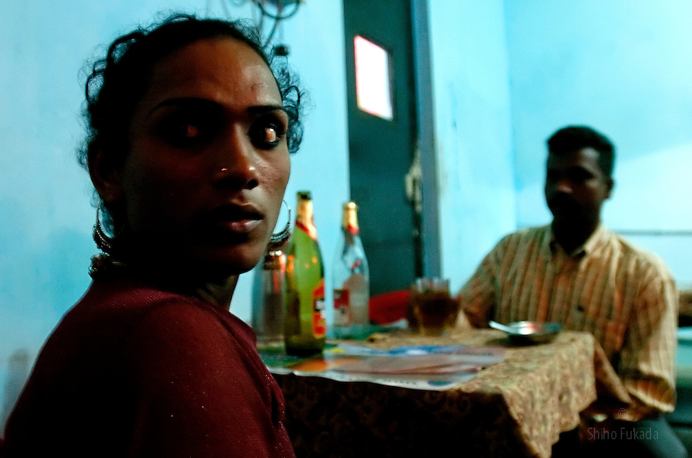 """Transgender sex worker drinks with her client in Villupuram, India. As transgenders,""""hijras"""" in local terms, are acutely marginalized in Indian society, the major earning avenues for them are sex work, begging and performing at rituals."""