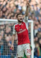 Football - 2016 / 2017 Premier League - Chelsea vs. Arsenal <br /> <br /> Shkodran Mustafi of Arsenal with finger in the air at Stamford Bridge.<br /> <br /> COLORSPORT/DANIEL BEARHAM
