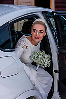 Norwegian bride arriving at the Plassen Church (kirke) for her winter wedding ceremony,  Plassen Church (kirke), a wooden (stave) church originally built in 1879. It burnt to the ground in 1904 and was rebuilt in 1907. Trysil, Norway.